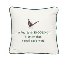 A Bad Day's Shooting Humorous cushion with a contrast piping, embroidered motif and lettering on a cream cotton cushion cover.