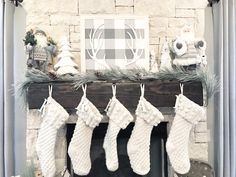 Neutral Christmas stockings in a white cable knit.