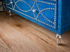 Engineered hardwood flooring adds warmth and style to the space, without sacrificing function in a high-traffic area.