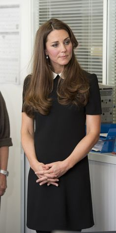 Kate Middleton wore this black Topshop dress as she visited the headquarters of Child Bereavement UK.                                     via @AOL_Lifestyle Read more: http://www.aol.com/article/2013/05/24/kate-middletons-pregnancy-style/20504296/?a_dgi=aolshare_pinterest#slide=26367 fullscreen