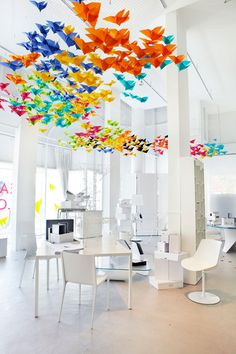 This is a very different type of art work for a space. I love how the paper butterflies are hanging from the celing adds a nice pop of colour to the space