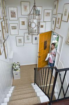 two story foyer-artwork interesting light fixture