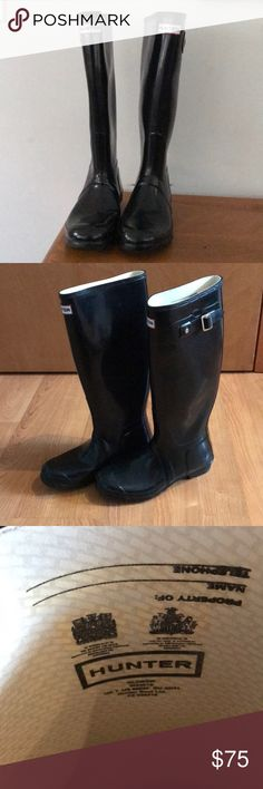 Tall Hunter Rain boots Hunter tall black glossy boots. Good used condition. Some markings on outside/normal wear.  The right shoe has a small indentation on the toe and shaft due to the way it was stored. It does not impact the way it feels when worn. No box. Hunter Shoes Winter & Rain Boots