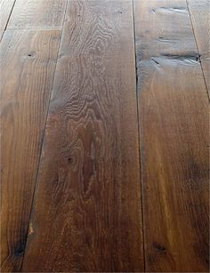 Antique heart pine flooring shown with a dark stain for Tobacco pine flooring