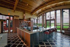 """Raise a Glass"" is the winner of the Best Kitchen and 1st Place Large Kitchen awards.It features a blend of woods, stainless steel, concrete and glass. Photo by Dennis Martin."""