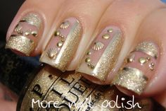 nail polish with gold trinkets and studs | Gold nails just for me featuring shell studs
