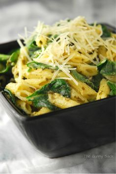 Ingredients1/3 cup prepared pesto  1/2 cup mayonnaise  6 oz bag of baby spinach  4 cups mini penne - cooked  Shredded ParmesanInstructionsMix together pesto and mayonnaise.  Toss creamy pesto with spinach and penne in a large bowl until well coated.  Sprinkle with Parmesan.
