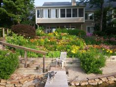 My dad, a retired teacher, single-handedly maintains this terraced, lake-edge garden. : gardening
