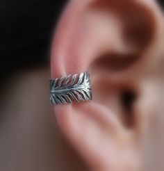 Sterling Silver Handcrafted Feather Textured Ear Cuff Vintage/Antique/Cartilage/catchless/helix. $14.95, via Etsy.
