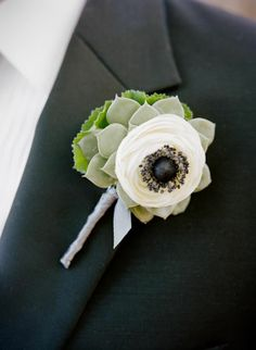Layered textured boutonniere - fantastic for the right wedding palette! The flower is a ranunculus tricked out with an anemone center - more costly and gorgeous. Or just use the anemone that has fewer petals.