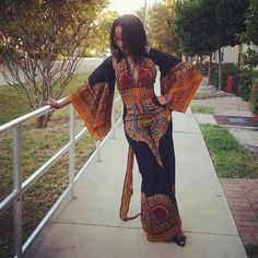 If that were a maxi dress instead of jumpsuit... Those sleeves are amazing, and the print is very boho.
