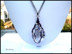 """This necklace is for those of us that love to wear fine pieces of art.     Starting with a 1""""x1 1/2"""" teardrop clear glass pendant, I have hand wire wrapped this luxurious pendant with purple 20 gauge"""
