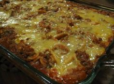 1 (1 lb) box angel hair pasta  1/2 cup Parmesan cheese  2 eggs  1/3 cup milk  1/2 cup margarine  1 1/2 lbs ground beef  2 teaspoons minced garlic  1/2 cup chopped onion  1/2 cup chopped green pepper (optional)  1/2 cup mushroom (optional)  1 (26 ounce)