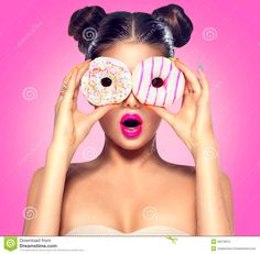 Beauty model girl taking colorful donuts