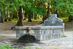 Stock photo available for sale at FeaturePics: Photo of Old watering place for animals in Manziana forest, Lazio, Italy.