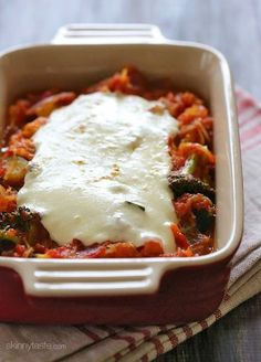 Spaghetti squash and fresh vegetables simmered with a quick marinara sauce and topped with fresh mozzarella if you desire - easy, cheap, gluten-free and perfect for Meatless Mondays!
