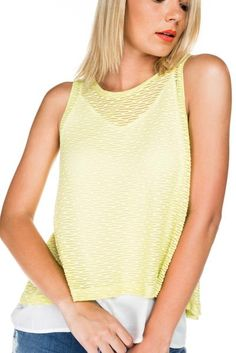 About Me; Sleeveless top in a lightweight lemonknitted fabric, with a white viscose cami underneath. Hemline of cami falling below top. Flared A line style. F