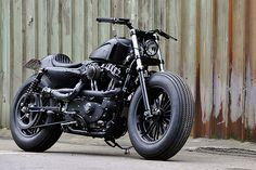 """Rough Crafts' """"Bomb Runner"""" custom Harley Sportster. One of the standout customs of the past year. Featured in the new 2013 Bike EXIF motorcycle calendar: http://www.octanepress.com/book/bike-exif-custom-motorcycle-calendar-2013"""