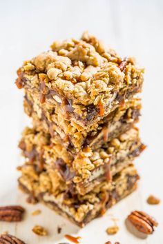 Salted Caramel Candied Pecan Carmelitas - The best carmelitas ever!! Chocolate, oats, candied pecans, and dripping with salted caramel! Beyond words amazing and an absolute must-make!!