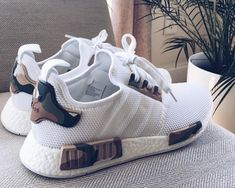 220ed0c4ddc00 This adidas NMD White Camo Custom designed by Alexander-John takes the Triple  White adidas NMD and adds Camouflage detailing for a perfect Camo adidas NMD .