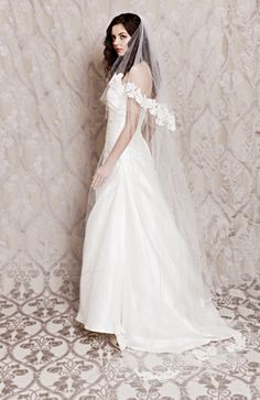 The shoulder framing cascade cut of this blusher perfectly complements a hi-low hemline.  Remove the cathedral tier for a twirl-worthy reception veil! Alicia alencon lace veil by Laura Jayne