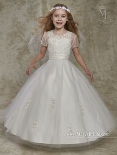 Tulle and lace flower girl ball gown with V-neck, pleated waist line, back zipper closure, and sheer bolero.