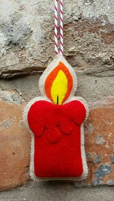 Felt candle christmas ornament by TillysHangout on Etsy Mais MaisFelt candle christmas ornament - I see a bigger version as a pillowHere is my felt candle ornament. It has been made with wool felt and has been entirely hand stitched. It measures appr Felt Christmas Decorations, Felt Christmas Ornaments, Christmas Candles, Diy Ornaments, Beaded Ornaments, Christmas Projects, Felt Crafts, Holiday Crafts, Felt Projects