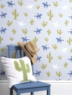 A fun cowboy and cactus motif print #wallpaper with a nod to the designs of the 50's.