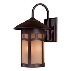 Design details are the focus of the Beacon Rhodes™ large exterior sconce, with an arts and crafts style that provides style and warmth.      Hand Applied Multi-Step Finish.  Metal Candle Sleeves.      Note: Finishes may vary due to chemical processes and the nature of handcraftsmanship.