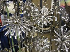 Silverware sculpted flowers. This is a great idea, I always see old silverware I…