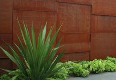 Modern Corten wall. This web page has lots of good landscaping photos with Corten.
