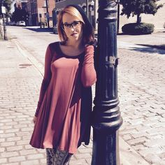 Brick, lightweight tunic  Only 1 Left  This tunic is a great basic go to tunic. It is a gorgeous brick color and has a loose, flowy look. It is available in a S. It is made to fit loosely. This tunic looks great with some skinnys and converse for a casual, chill vibe. Boutique Tops Tunics