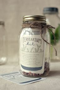Terrarium Kit-----Place about a an inch of stones on bottom of canning jar. Sprinkle activated charcoal (purchased at pet store) over top.  Add a few inches of potting soil  tuck a small plant in to the soil.  Add decorations if desired. Print label(download on website)  tie ribbon around lid.