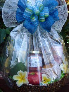 Beautiful Custom Baskets w/Fresh Fruit and premium made in Hawaii snacks and tropical juice. Hand Delivery on the island of O'ahu, Hawaii.