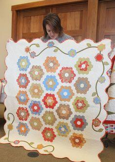 Beautiful hexagon quilt from fig tree fabrics