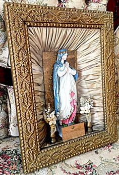 Antique 1889 Gilt Virgin Mary Shrine Statue Shadow box (Image1)This 19th century shadow box features a plaster or chalkware statue of the Blessed Mother Virgin Mary along with a prayer petition card and silk fabric all under glass. This was made in memory of the Johnstown flood where everything in the town was wiped out except for a statue of the Blessed Mother which was left standing among all the devastation.  The back tells a story, copyright 1889, Collins-Campbell co