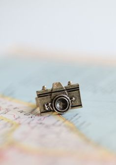 lasting memories camera ring in brass $8.99 (For more than one friend...)