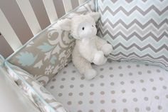So freaking cute. The bedding is perfect (LOVE the different patterns) and the lamb stuffed animal is adorable.