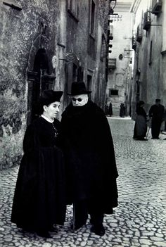 In the streets of Scanno, Italy, 1955  photo by Henri Cartier-Bresson. S)