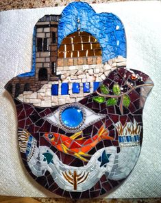 """Judaica Hamsa Mosaic Wall Art """"Reflection"""" 12"""" x 9""""  Made from mirror glass, tempered glass, copper wire, millefiori, smalti, marble, stained glass, glass tile, glass gems, beads, porcelain and unglazed ceramic tile. Its one of my favorite pieces of art! www.BellaArtMosaics.com"""