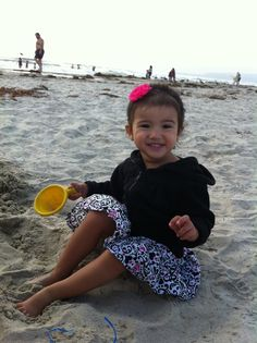 2.5-year-old Sienna playing in the sand. Submitted by Devon F.  -- Choose your favorite photo and submit your vote by August 6, 2012 for a chance to win a gift card for children's books!