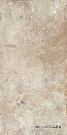 """L'effetto cemento della collezione Action di Fondovalle incontra le tracce di un """"vissuto creativo"""", evidente nei passaggi tonali di colore e nel segno libero e quasi """"dipinto"""" del decoro: stratificazioni materiche e cromatismi inediti che parlano di arte, design e artigianato."""