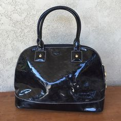 Queen by queen Latifah bowling bag In good condition! Red interior:) minor scratches on bottom four corners ( don't show while you are wearing bag- refer to last pix) Queen Bags
