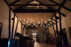 Rustic wood interior design with mason jar light chandelier!