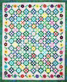 Colorful nine-patch squares and hourglass blocks are at the heart of Taffy Blossoms. The floral border design adds a whimsical touch to this summer garden creation. Easy-to-use Rainbow Clover Bias. Nine Patch Quilt, Rainbow Quilt, Bird Quilt, Quilting Board, Machine Quilting Designs, Quilt Border, Quilt Sizes, Scrappy Quilts, Quilting Tutorials