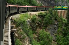 """""""Built in 1898 during the Klondike Gold Rush, the narrow-gauge WPYR starts from the Taiya Inlet quaysides of Skagway, Alaska, and climbs 2,880 ft (878 m) over the White Pass into Canada's Yukon territories and some of the north's most rugged terrain.""""  Cool!"""