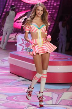 Cara Delevingne on the Victoria's Secret catwalk @Christina Kasper Now in addition to our walking around in wings we can now dress as a piece of candy wearing ridiculous heels yes! SCORE! lol