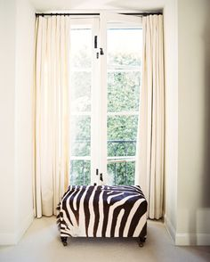 via Lonny Blog.  Love curtains hung from ceiling in same color as wall