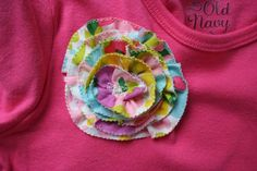 As promised, here's a little how-to on the fabric ranunculus. First, cut your fabric into strips on the bias. The width and length of your strips depends on how big you want your finished flower to be. For this small...