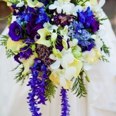 "Jewel toned wedding flowers give this Sierra Nevada wedding a ""pop"" of color and richness."